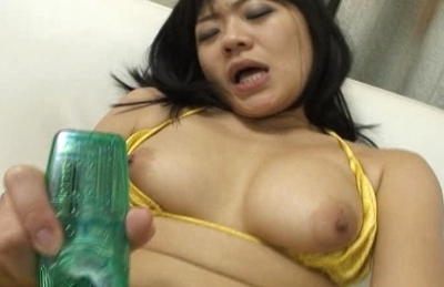 Big-tittied Asian hottie masturbates her hairy beaver and fingers anal